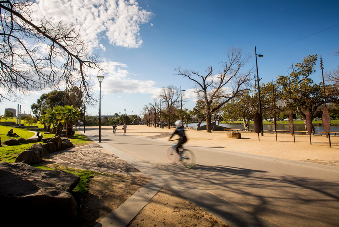 Person cycling in at Birrarung Marr park.