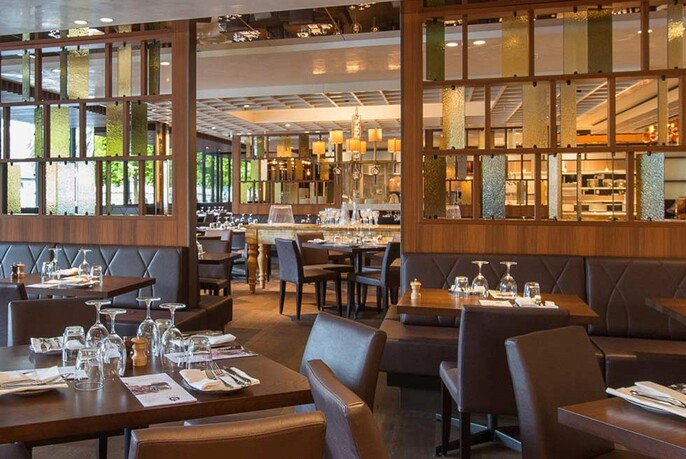 The interior of Gradi showing a large dining room with tables set for guests.