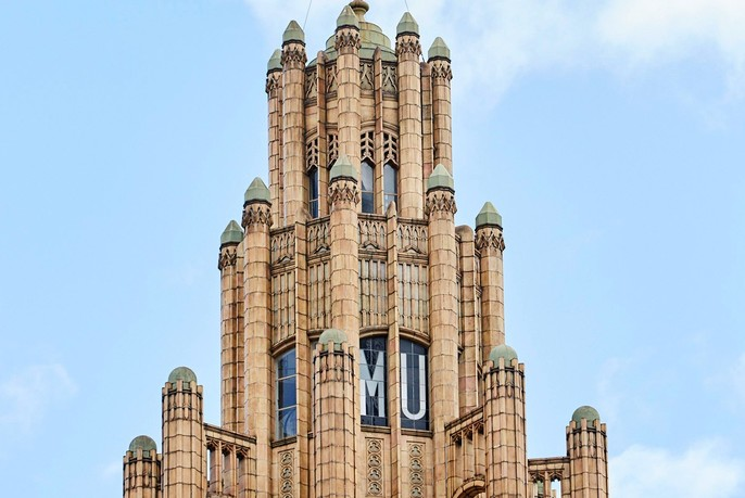 Turreted Gothic-style tower of Manchester Unity Building.