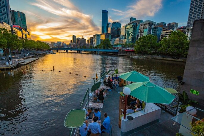 Sunset view looking down on Ponyfish Island Bar with the sky reflected on the Yarra River.