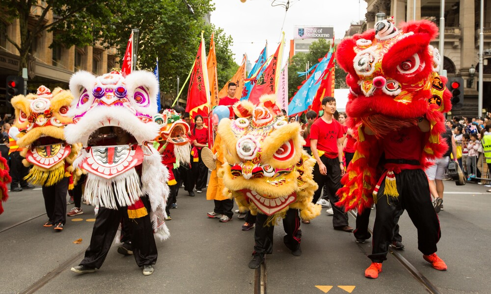 Chinese dragons at the front of a festival parade.