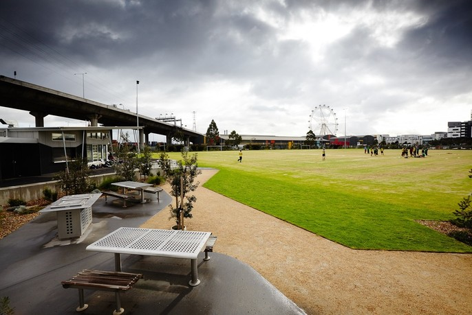 Barbeque facilities and sports field at Ron Barassi Senior Park.