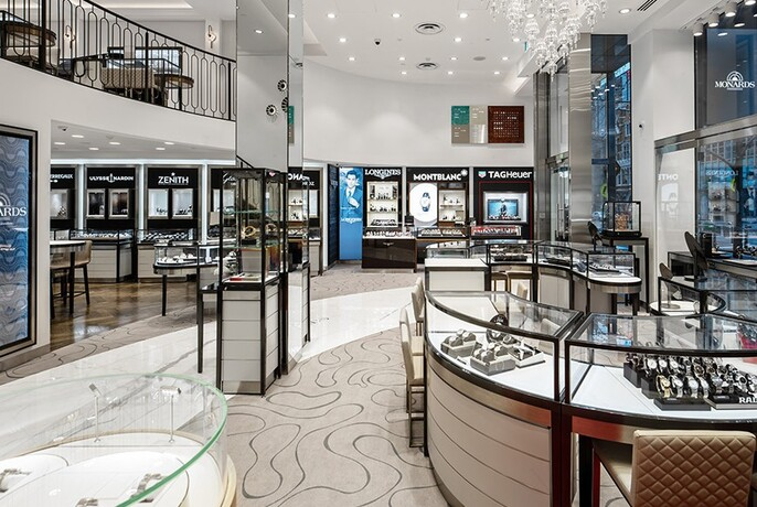 Store interior with display cases of watches.