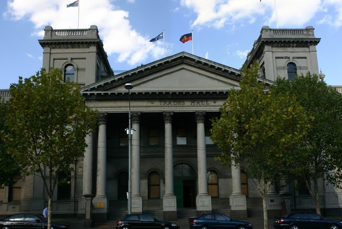 Columns and pediment of neoclassical Trades Hall building.