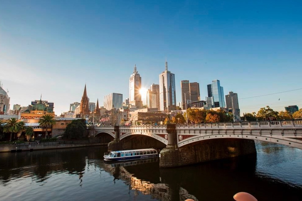 Woman's hands with glossy, dark red nail polish.