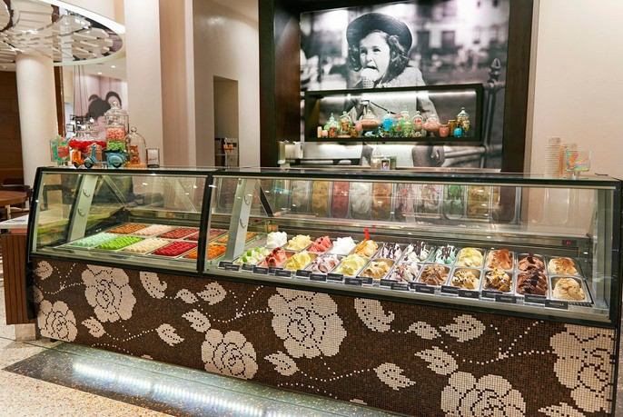 Macarons and gelati in long display cabinet