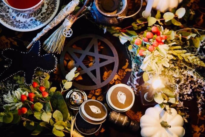 Close up of herbs, candles and other pagan and Wiccan products.