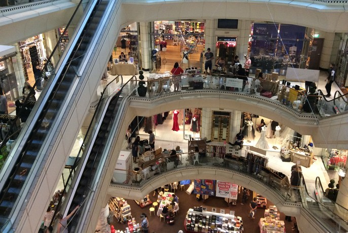 Inside Collins234 shopping centre, showing several levels of shopping, connected by escalators.