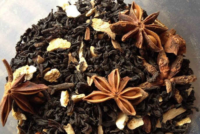 Loose-leaf tea with star anise and other spices.