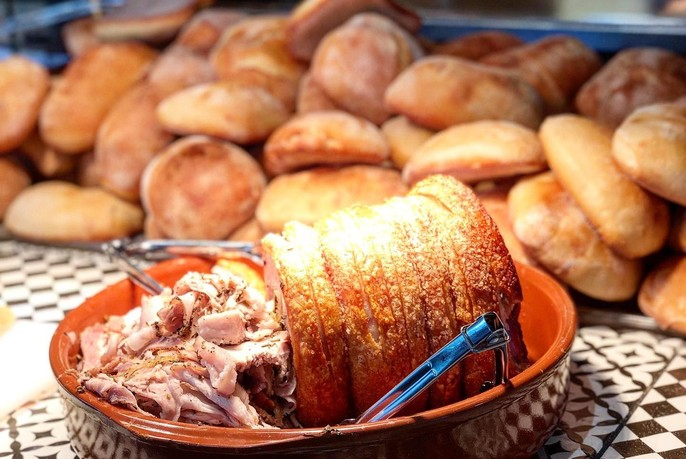 Roasted meat with crackling and bread rolls.