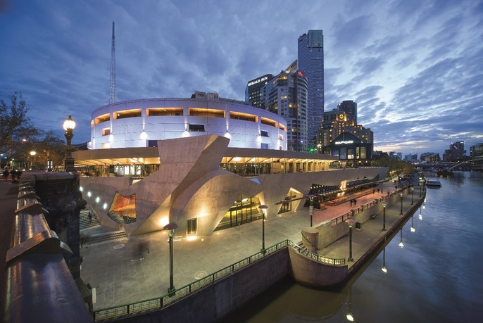 Hamer Hall and the Arts Centre at night,beside the Yarra River.