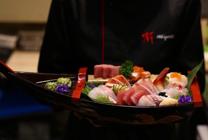 A selection of sashimi carried by a waiter at Miyako Japanese Cuisine and Teppanyaki.
