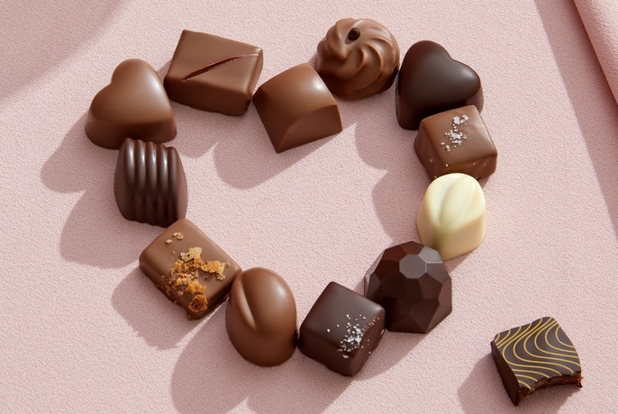 Selection of chocolates arranged into a heart shape.