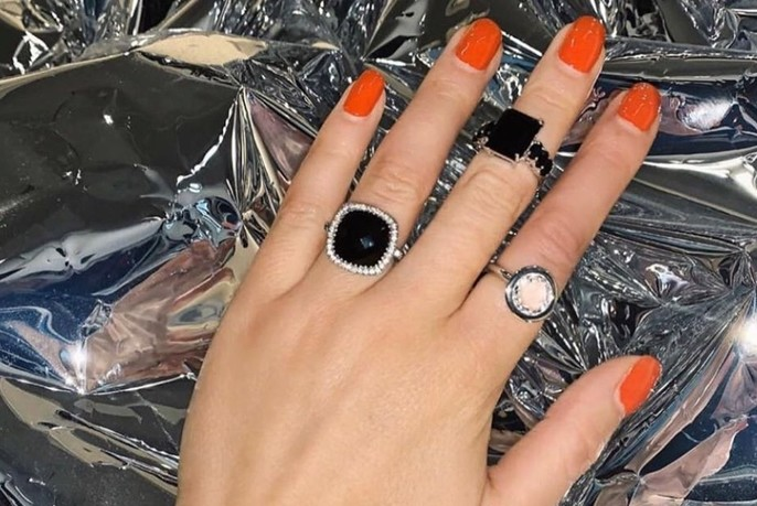 Three different rings, including two square black ones.