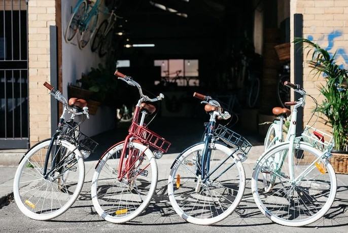 Four authentic Dutch bikes displayed outside the Lekker storefront.
