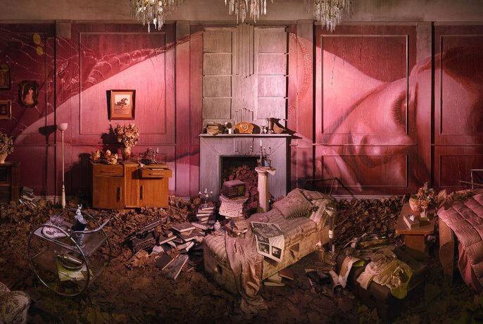 Artist Rone's pink-hued room installation depicting a dishevelled interior.