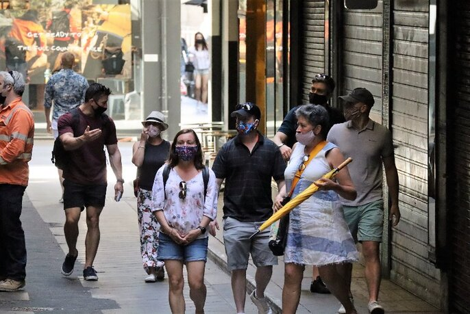 People wearing face masks on a small group walking tour of the city.