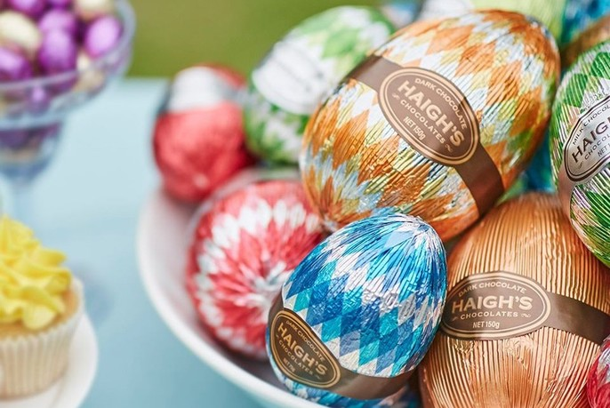 Chocolate Easter eggs covered in brightly-coloured foil.