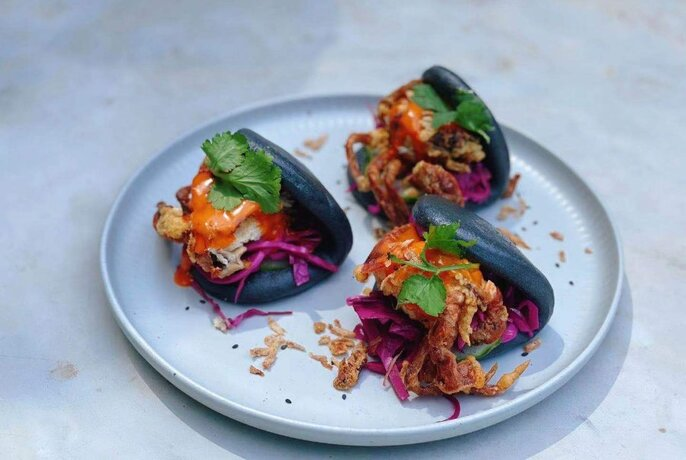 Soft shell crab sliders in black bao.